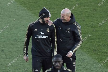 Real Madrid's head coach Zinedine Zidane (R) and Karim Benzema chat during the team's first training session after the Christmas recess at the Alfredo Di Stefano sports complex in Madrid, Spain, 30 December 2019.