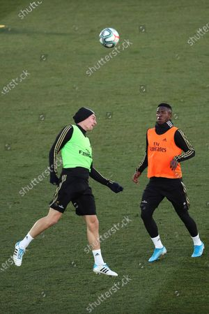 Real Madrid's Toni Kroos (L) and Vinicius Jr. (R) attend the team's first training session after the Christmas recess at the Alfredo Di Stefano sports complex in Madrid, Spain, 30 December 2019.