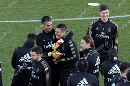 Real Madrid's players Alphonse Areola (C-L) and Casemiro (C-R) attend the team's first training session after the Christmas recess at the Alfredo Di Stefano sports complex in Madrid, Spain, 30 December 2019.