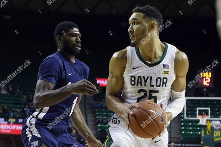 Baylor forward Tristan Clark (25) looks to pass against Jackson State guard Roland Griffin (1) in the first half of an NCAA college basketball game, in Waco, Texas