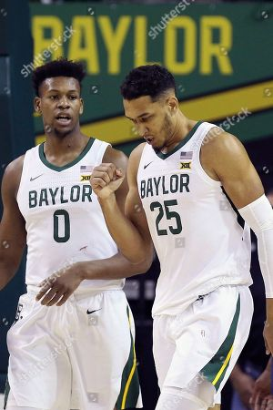 Baylor forward Tristan Clark (25) reacts with teammate Baylor forward Flo Thamba (0) after scoring against Jackson State in the second half of an NCAA college basketball game, in Waco, Texas