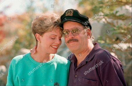 """TENNILLE DRAGON. Toni Tennille, left, and Daryl Dragon, of the singing duo Captain & Tennille, pose during an interview in Washoe Valley, Nev. on . Dragon, who teamed with then-wife Tennille on such easy listening hits as """"Love Will Keep Us Together"""" and """"Muskrat Love,"""" died on Jan. 2. He was 76"""