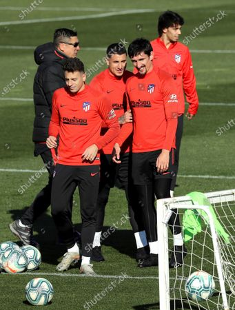 Atletico Madrid's assistant coach German Burgos (L) walks past the players (from left) Colombian defender Santiago Arias,Uruguayan defender Jose Maria Gimenez, Montenegran defender Stefan Savic and Portuguese forward Joao Felix during a team's training session at Wanda sport complex in Majadahonda, outside Madrid, Spain, 31 December 2019. The team prepares its upcoming LaLiga game against Levante at Madrid's Wanda Metropolitano Stadium next 04 January.