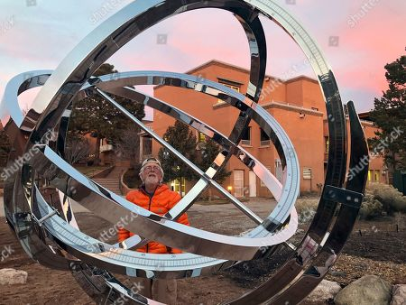Stock Photo of Bill Donahue, a retired teacher and director of laboratories at St. John's College, uses an armillary sphere to track planetary rotations and explore the history of astronomy in Santa Fe, N.M. The unique precision-steel replica of an instrument created by Danish astonomer Tycho Brahe was commissioned by graduates of the college where students trace the evolution of math and science from early civilizations