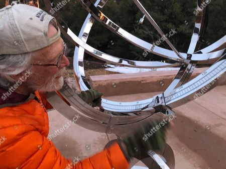 Bill Donahue, a retired teacher and director of laboratories at St. John's College, adjusts the site on an armillary sphere to track planetary rotations and explore the history of astronomy in Santa Fe, N.M. The unique precision-steel replica of an instrument created by Danish astonomer Tycho Brahe was commissioned by graduates of the college where students trace the evolution of math and science from early civilizations