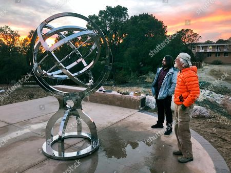 Stock Picture of Bill Donahue, right, a retired teacher and director of laboratories at St. John's College, and student Devin Ketch use an armillary sphere to track planetary rotations and explore the history of astronomy in Santa Fe, N.M. The unique precision-steel replica of an instrument created by Danish astonomer Tycho Brahe was commissioned by graduates of the college where students trace the evolution of math and science from early civilizations