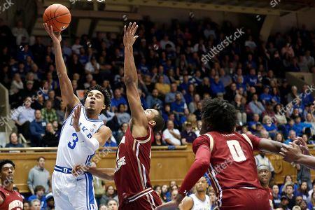 Duke guard Tre Jones (3) shoots while Boston College forward CJ Felder (0) and forward Steffon Mitchell defend during the first half of an NCAA basketball game in Durham, N.C