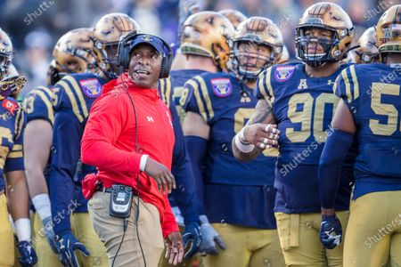 Stock Picture of Navy Midshipmen assistant coach Robert Green stands with the defense during a timeout in the 61st annual AutoZone Liberty Bowl Football Classic between the Navy Midshipmen and the Kansas State Wildcats at Liberty Bowl Memorial Stadium in Memphis, Tennessee. Navy defeated Kansas State 20-17. Prentice C