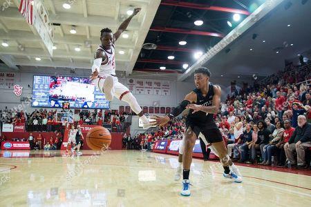 Butler forward Jordan Tucker (1) passes the ball past St. John's guard Rasheem Dunn (3) during the second half of an NCAA college basketball game, in New York