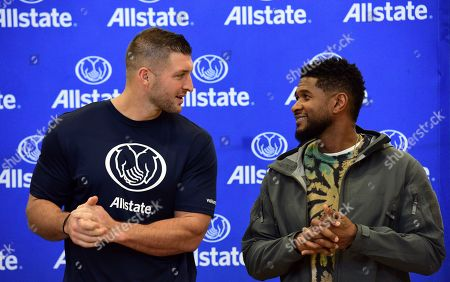 Usher, Tim Tebow. IMAGE DISTRIBUTED FOR ALLSTATE - Multi-platinum selling artist Usher joins forces with Tim Tebow, the 2019 Allstate AFCA Good Works Team and Allstate volunteers at a community service project to benefit the Einstein Charter School ahead of the 2020 Allstate Sugar Bowl, in New Orleans