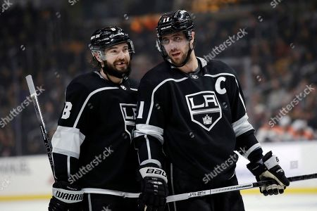 Anze Kopitar, Drew Doughty. Los Angeles Kings' Anze Kopitar, right, talks to Drew Doughty during the second period of an NHL hockey game against the Philadelphia Flyers, in Los Angeles