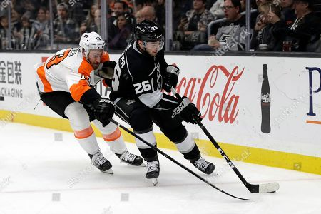 Sean Walker, Kevin Hayes. Los Angeles Kings' Sean Walker, right, is defended by Philadelphia Flyers' Kevin Hayes during the second period of an NHL hockey game, in Los Angeles