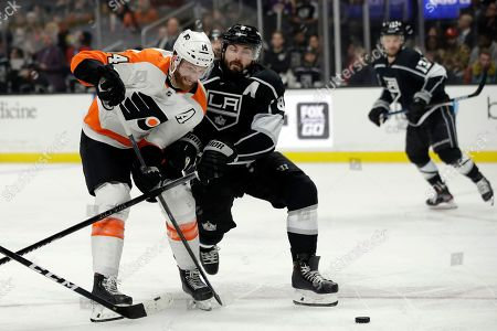 Sean Couturier, Drew Doughty. Philadelphia Flyers' Sean Couturier, left, is defended by Los Angeles Kings' Drew Doughty during the third period of an NHL hockey game, in Los Angeles