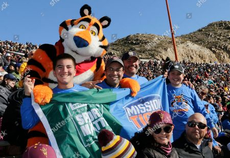 Tony the Tiger welcomes special guests from El Paso middle schools during the Tony the Tiger Sun Bowl game between Florida State and Arizona State, in El Paso, Texas. Earlier this month, Tony visited their schools along with Sun Bowl alum and football hall of famer LaDainian Tomlinson. Together, they announced that Kellogg's Frosted Flakes' Mission Tiger and The DICK'S Sporting Goods Foundation partnered to help give El Paso middle school kids the chance to play sports, donating a total of $500,000 in Sports Matter grants to El Paso public middle schools