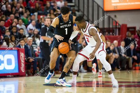 Stock Image of Butler forward Jordan Tucker (1) and St. John's guard Rasheem Dunn (3) fight for possession of the ball during the second half of an NCAA college basketball game, in New York. Butler won 60-58