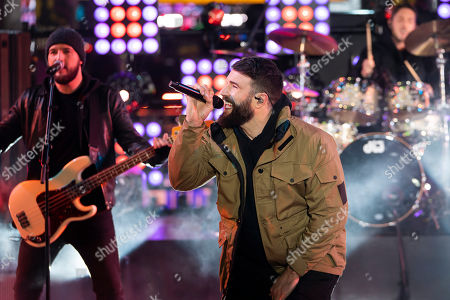 Sam Hunt performs on stage at the Times Square New Year's Eve celebration, in New York