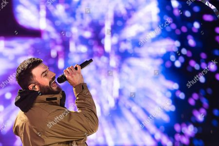 Sam Hunt performs at the Times Square New Year's Eve celebration, late, in New York