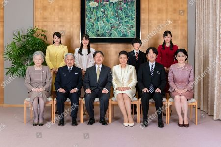 Stock Image of Released by Imperial Household Agency of Japan, Japan's Emperor Naruhito, seated third from left, and Empress Masako, seated third from right, pose with their family members for a family photo session for the New Year, at their residence in Tokyo. Imperial family members are, front left to right, Empress Emerita Michiko, Emperor Emeritus Akihito, Naruhito, Masako, Crown Prince Akishino, and Crown Princess Kiko, and, back from left to right, Princess Mako, Princess Aiko, Prince Hisahito, and Princess Kako