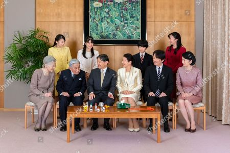 Stock Picture of Released by Imperial Household Agency of Japan, Japan's Emperor Naruhito, seated third from left, and Empress Masako, seated third from right, smile with their family members for a family photo session for the New Year, at their residence in Tokyo. Imperial family members are, front left to right, Empress Emerita Michiko, Emperor Emeritus Akihito, Naruhito, Masako, Crown Prince Akishino, and Crown Princess Kiko, and, back from left to right, Princess Mako, Princess Aiko, Prince Hisahito, and Princess Kako