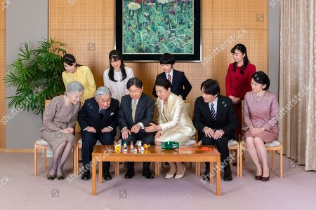 Stock Photo of This, photo released by Imperial Household Agency of Japan, shows Japan's Emperor Naruhito, seated third from left, and Empress Masako, seated third from right, with their family members during a family photo session for the New Year, at their residence in Tokyo. Imperial family members are, front left to right, Empress Emerita Michiko, Emperor Emeritus Akihito, Naruhito, Masako, Crown Prince Akishino, and Crown Princess Kiko, and, back from left to right, Princess Mako, Princess Aiko, Prince Hisahito, and Princess Kako