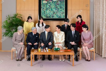 Released by Imperial Household Agency of Japan, Japan's Emperor Naruhito, seated third from left, and Empress Masako, seated third from right, pose with their family members for a family photo session for the New Year, at their residence in Tokyo. Imperial family members are, front left to right, Empress Emerita Michiko, Emperor Emeritus Akihito, Naruhito, Masako, Crown Prince Akishino, and Crown Princess Kiko, and, back from left to right, Princess Mako, Princess Aiko, Prince Hisahito, and Princess Kako