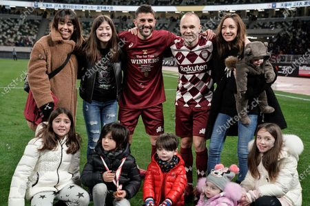 Andres Iniesta (2-R, back) and David Villa (C, back) of Vissel Kobe pose for a photo with their respective families after the victory against Kashima Antlers in the final match of the Emperor's Cup at New National Stadium in Tokyo, Japan, 01 January 2020.