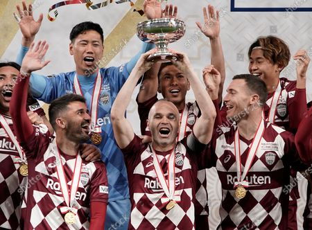 Captain Andres Iniesta (C) of Vissel Kobe raises the Emperor's Cup in celebration with David Villa (C-L) and Thomas Vermaelen (R) from Belgium after winning the Emperor's Cup final over Kashima Antlers at new National Stadium in Tokyo, Japan, 01 January, 2020. The stadium is the main stadium for Tokyo 2020 Olympic and Paralympic Games. Kobe won the Emperor's Cup.