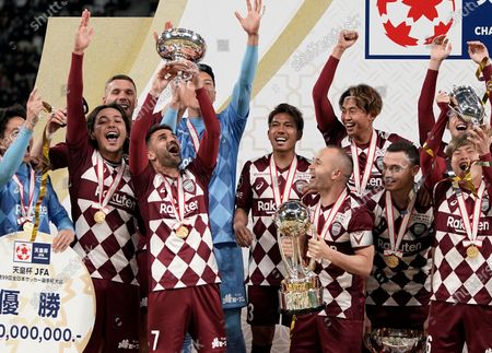 David Villa (3-L, front) of Vissel Kobe raises the Emperor's Cup as team captain Andres Iniesta (3-R, front) looks on while the team celebrate their victory against Kashima Antlers in the final match of the Emperor's Cup at New National Stadium in Tokyo, Japan, 01 January, 2020.