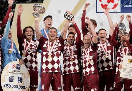 Lukas Podolski (3-L) of Vissel Kobe raises the Emperor's Cup next to David Villa (C), Andres Iniesta (3-R), Thomas Vermaelen (2-R) and other teammates as the team celebrate their victory against Kashima Antlers in the final match of the Emperor's Cup at New National Stadium in Tokyo, Japan, 01 January, 2020.
