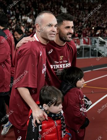 Andres Iniesta (L) and David Villa (R) of Vissel Kobe pose for a photo with their daughters as they celebrate after the victory against Kashima Antlers in the final match of the Emperor's Cup at New National Stadium in Tokyo, Japan, 01 January, 2020.