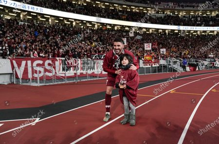David Villa (R) of Vissel Kobe poses for a photo with his daughter as he celebrates after the victory against Kashima Antlers in the final match of the Emperor's Cup at New National Stadium in Tokyo, Japan, 01 January, 2020.