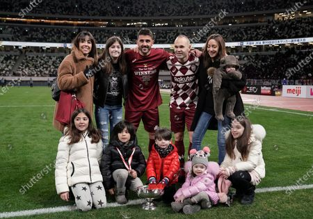 Andres Iniesta (2-R, back) and David Villa (3-L, back) of Vissel Kobe pose for a photo with their respective families after the victory against Kashima Antlers in the final match of the Emperor's Cup at New National Stadium in Tokyo, Japan, 01 January 2020.