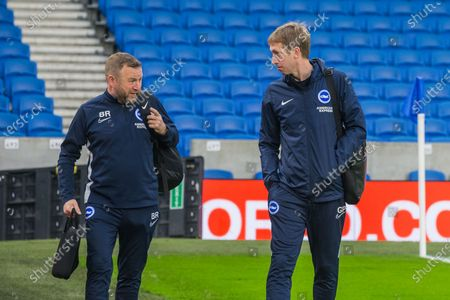 Billy Reid, Assistant Head Coach of Brighton & Hove Albion FC & Graham Potter, Head Coach of Brighton & Hove Albion FC arriving at the American Express Community Stadium ahead of the Premier League match between Brighton and Hove Albion and Chelsea at the American Express Community Stadium, Brighton and Hove