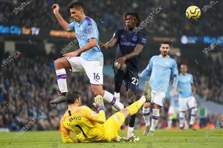 Manchester CityÕs goalkeeper Claudio Bravo bottom fails to clear from EvertonÕs Moise Kean centre right as Rodri left leaps clear in the run up to Everton scoring