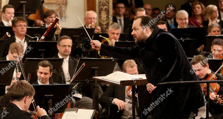 Stock Picture of Latvian conductor Andris Nelsons conducts the Vienna Philharmonic Orchestra during the traditional New Year's concert at the golden hall of Vienna's Musikverein, in Vienna, Austria