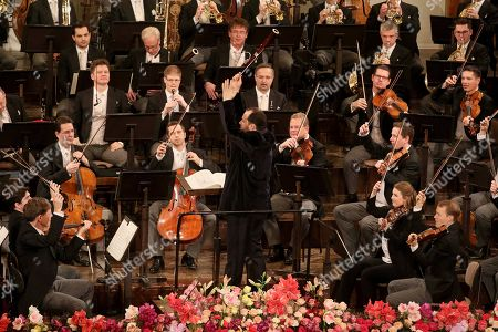 Stock Photo of Latvian conductor Andris Nelsons conducts the Vienna Philharmonic Orchestra during the traditional New Year's concert at the golden hall of Vienna's Musikverein, in Vienna, Austria