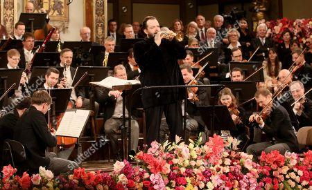 Latvian conductor Andris Nelsons conducts the Vienna Philharmonic Orchestra during the traditional New Year's concert at the golden hall of Vienna's Musikverein, in Vienna, Austria