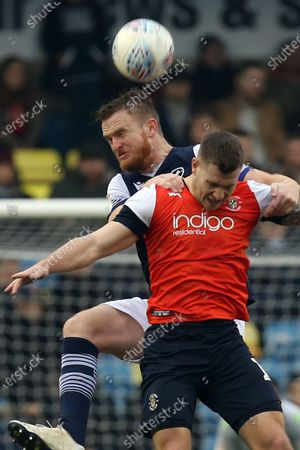 Alex Pearce of Millwall and James Collins of Luton Town during Millwall vs Luton Town, Sky Bet EFL Championship Football at The Den on 1st January 2020