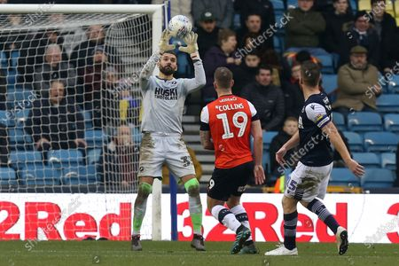 Bartosz Bialkowski of Millwall collects the ball ahead of James Collins of Luton Town during Millwall vs Luton Town, Sky Bet EFL Championship Football at The Den on 1st January 2020