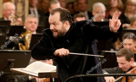 Stock Image of Latvian conductor Andris Nelsons conducts the Vienna Philharmonic Orchestra during the traditional New Year's concert at the golden hall of Vienna's Musikverein, in Vienna, Austria