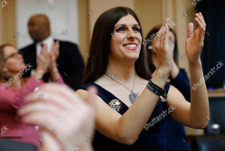 Stock Photo of Del. Danica Roem, D-Prince William, right, applauds visitors during opening ceremonies at the start of the 2019 session of the Virginia General Assembly in the House chambers at the Capitol in Richmond, Va. Supporters of the Equal Rights Amendment are confident Virginia is on the verge of becoming the critical 38th state to ratify the gender equality measure. The proposed 28th amendment to the U.S. Constitution faces a host of likely legal challenges and vehement opposition from conservative activists who depict the ERA as a threat to their stances on abortion and transgender rights