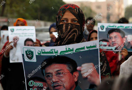 """Supporters of former Pakistani military ruler Gen. Pervez Musharraf protest a court's decision, in Karachi, Pakistan, . The Pakistani court's decision announced Dec. 17, 2019 sentenced Musharraf to death in a treason case related to the state of emergency he imposed in 2007 while in power, officials said. Musharraf is apparently sick and receiving treatment in Dubai where he lives. Placard reads """" Pakistan first"""