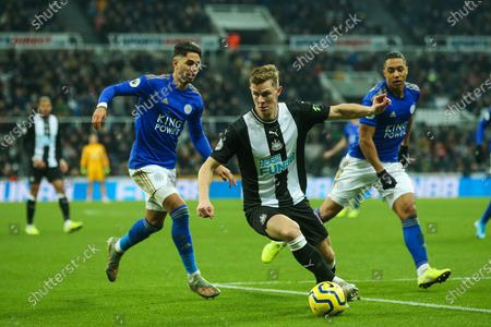 Emil Krafth (#17) of Newcastle United turns on the ball to evade the pressure being exerted by Ayoze Perez (#17) of Leicester City during the Premier League match between Newcastle United and Leicester City at St. James's Park, Newcastle