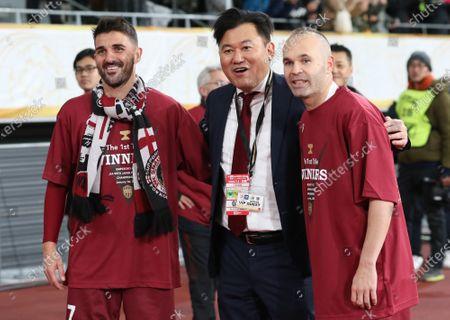 Andres Iniesta and David Villa of Vissel Kobe smile with Japan's e-commerce giant Rakuten president and owner of Vissel Kobe Hiroshi Mikitani