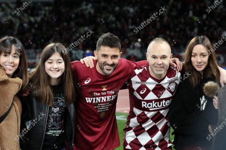 Andres Iniesta and David Villa of Vissel Kobe smile with their family members