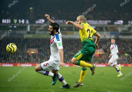 Teemu Pukki of Norwich City brings down James Tomkins of Crystal Palace