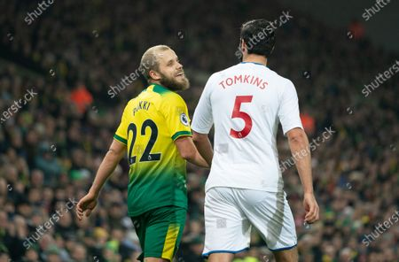 Teemu Pukki of Norwich City smiles at James Tomkins of Crystal Palace after the two collided