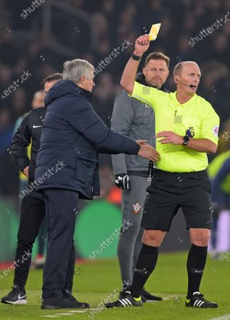 Tottenham Hotspurs manager Jose Maurinho (L) is yellow carded by referee Mike Dean watched by Southampton manager Ralph Hasenhuettl during the English Premier League soccer match Southampton vs Tottenham Hotspur at St.Marys stadium in Southampton, Britain, 01 January 2020.