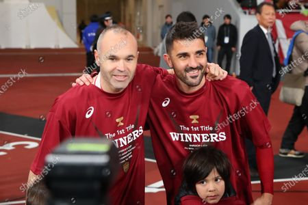 Stock Photo of Andres Iniesta and David Villa of Vissel Kobe celebrate after the final whistle