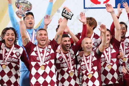 Lukas Podolski, David Villa and Andres Iniesta of Vissel Kobe celebrate after the final whistle